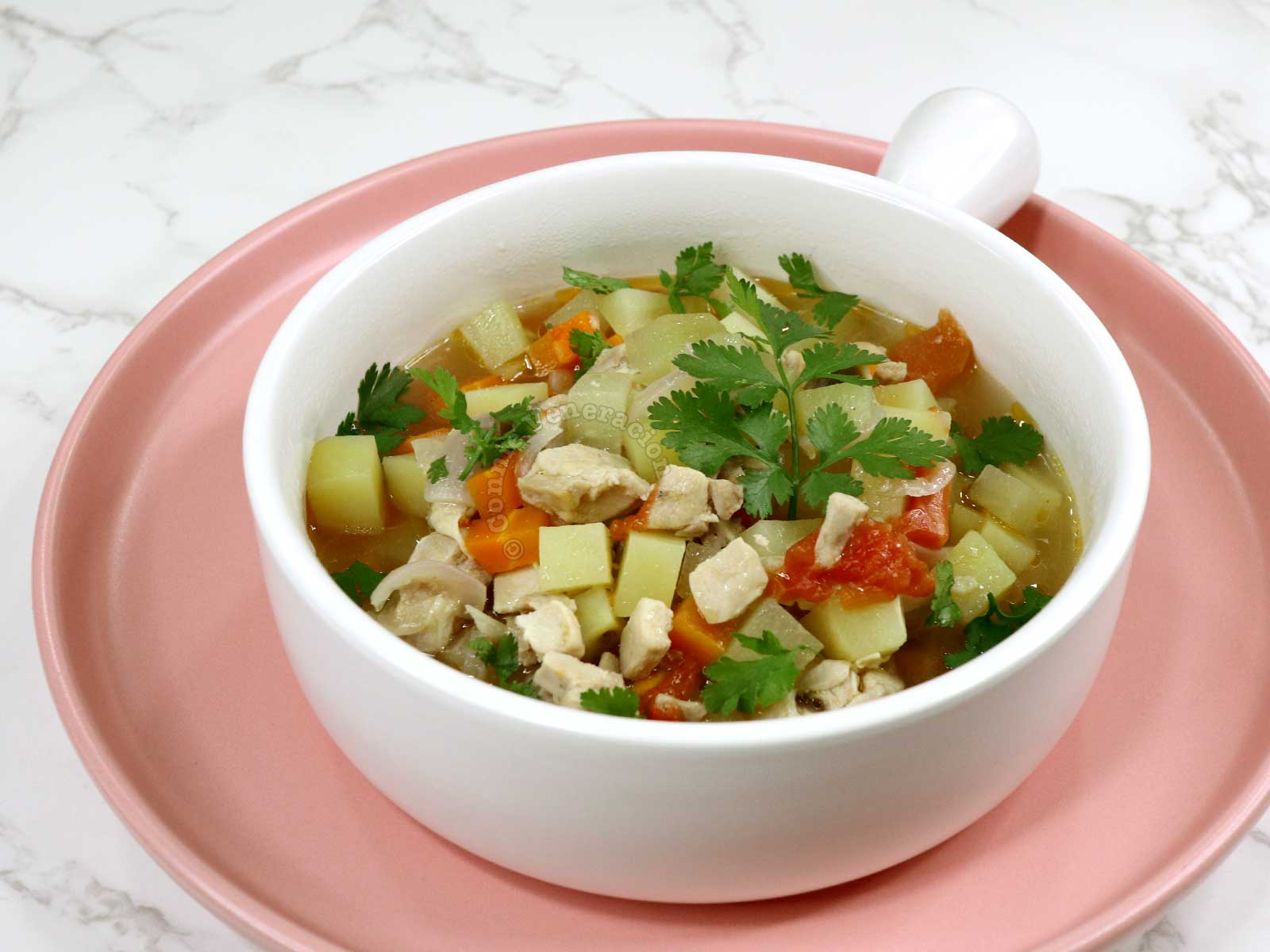Filipino chicken picadillo soup garnished with cilantro