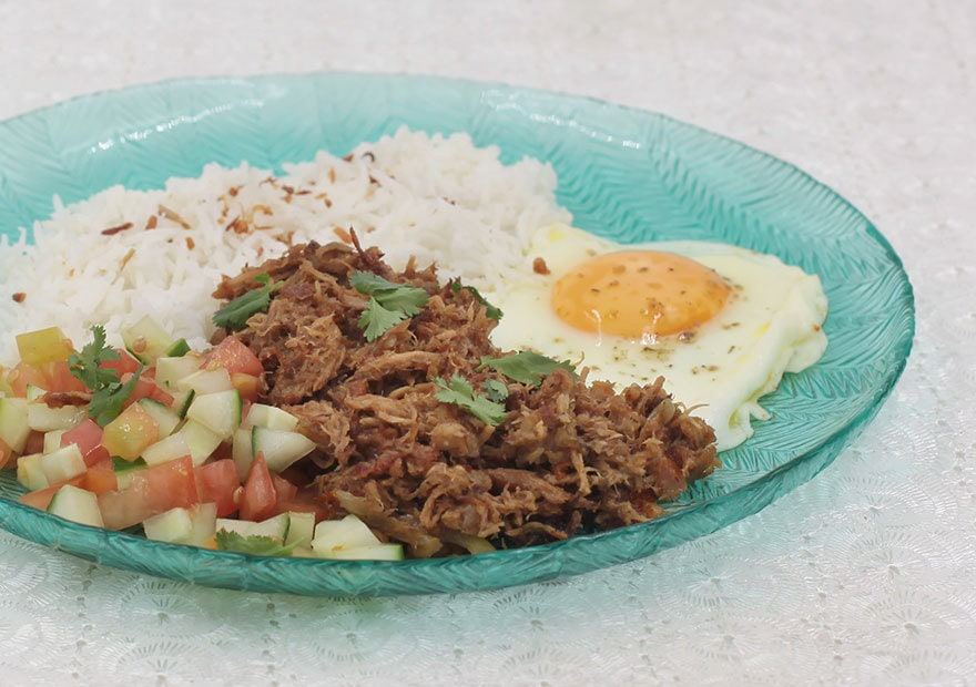 Learn how to make Mexican carnitas the easy way. Enjoy the tender meat with rice, egg and a simple salad.