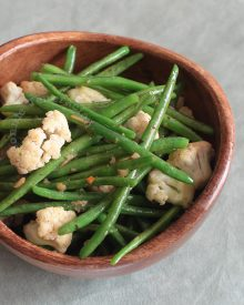 Spiced butter (with salt, Parmesan, basil, habanero and thyme) and a little garlic flavor the green beans and cauliflower. Perfect Thanksgiving side dish!