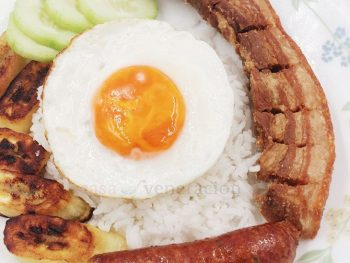 From Colombia comes bandeja paisa, a platter with an amazing variety of food that may include beans, chorizo, chicharron, plantain, egg and rice.