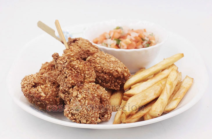 For added crunch and flavor, roll chicken in crushed nuts before frying. Alex's nut-crusted fried chicken on a stick is especially good with pico de gallo.