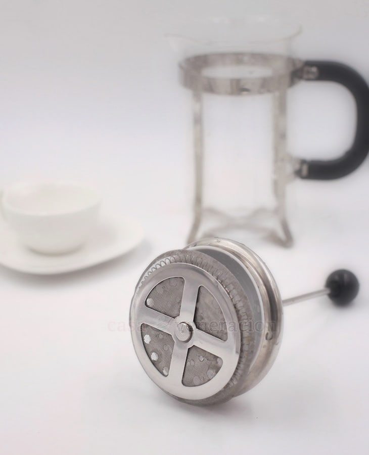 French coffee press parts: the plunger which consists of a cover, a rod and a disc with a mesh