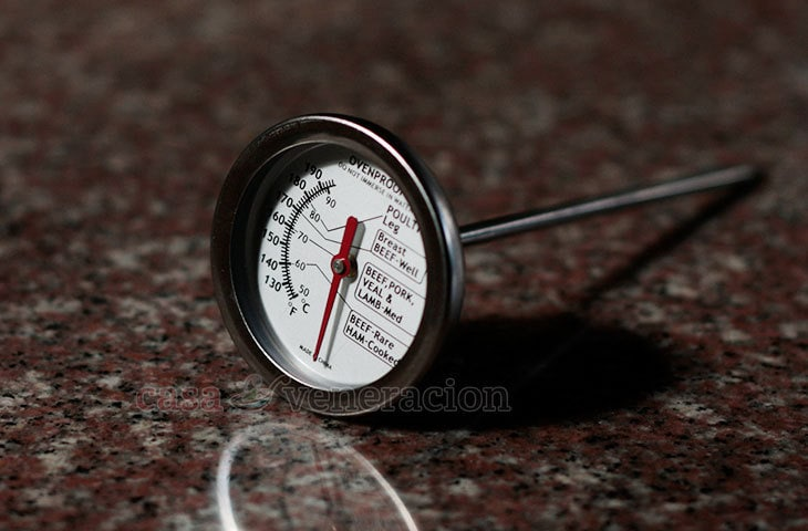A meat thermometer has two parts: the metal probe that is inserted into the meat and a dial to read the temperature.