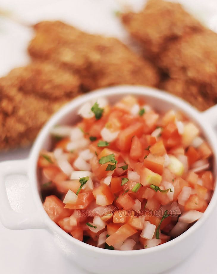 A Mexican salsa, pico de gallo is made with chopped tomato, onion, chili, cilantro, salt and lime juice. Enjoy it with meat, poultry or seafood.