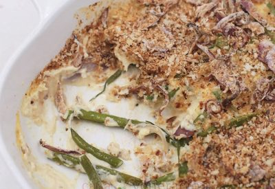 Green beans sauteed in butter is mixed with cream and topped with crispy onions and breadcrumbs. Get the recipe for crispy and creamy green beans casserole!