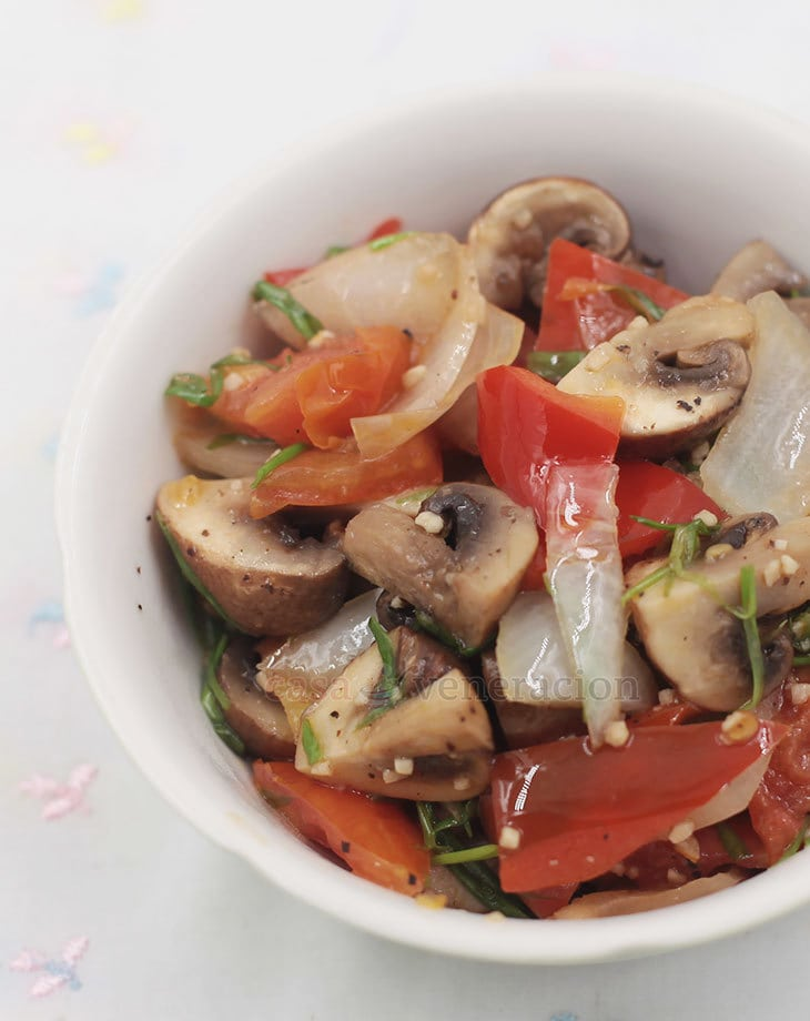An easy to prepare appetizer, these pepper garlic mushrooms are cooked with butter and lime juice. The red peppers add color and a subtle sweetness.