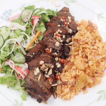 A family affair. My two daughters and I cooked lunch. Spicy pot roast seasoned with Asian spices was served with a citrusy salad and kimchi rice.