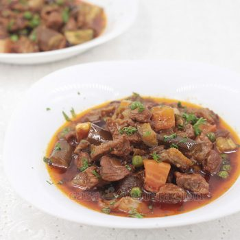 Similar to Filipino menudo, paprika and cranberry pork stew ditches the potatoes, peas, carrots, raisins and most of the tomato sauce. Instead, there's a copious amount of smoked paprika, dried cranberries, eggplants and sweet potatoes.