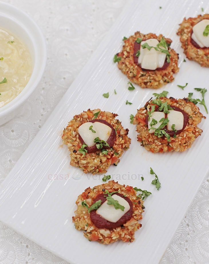 A delicious appetizer to start your holiday dinner (or finger food to go with cocktails), these cauliflower pizza bites have chopped nuts in them!
