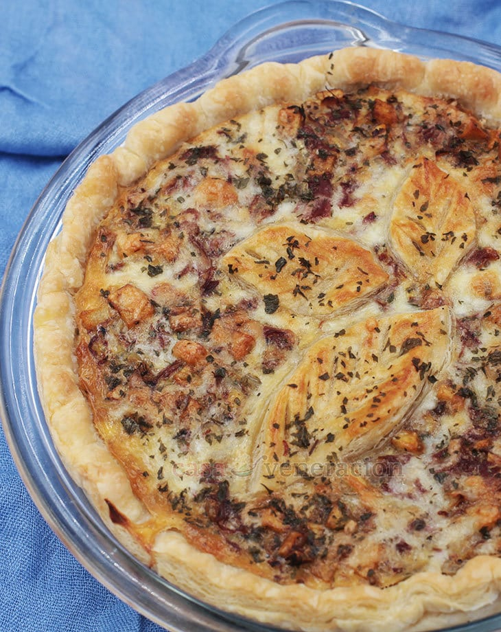 It's canned corned beef dressed up for the holidays! This corned beef omelet pie (quiche to the English) has potatoes, onions, herbs and puff pastry crust.