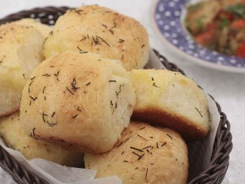 Indulgent bread perfect for holiday parties, these rosemary and garlic dinner rolls are brushed with butter before AND after going into the oven.