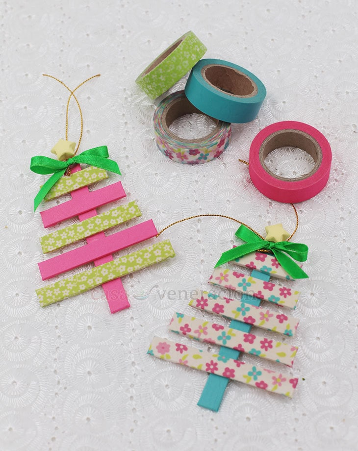 Graduated lengths of popsicle sticks were covered with washi tape then shaped to form a Christmas tree. On top is an origami star.