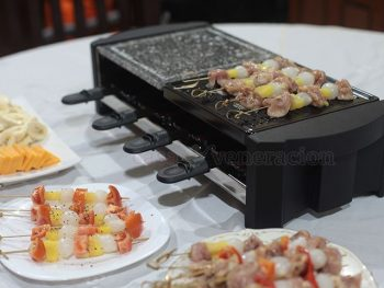 A wedding anniversary gift for me, a Severin raclette grill with a natural grill stone, non-stick grill plate and eight trays for melting cheese. It's fun!