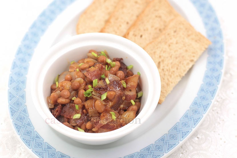 Pork and beans may be comfort food. But so is bacon. So, why not ditch the plain pork and use browned fatty bacon with your beans instead? Here's the trick. And the recipe.