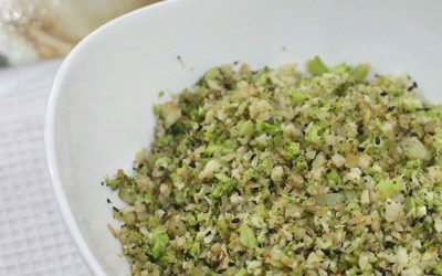 Chopped cauliflower and broccoli were sauteed with garlic, onion and herbs in sesame seed oil. Nuts and sesame seeds were added for crunch. It's keto diet compliant.