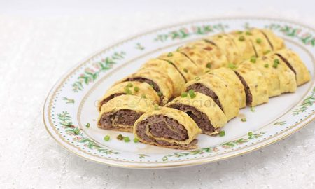 Thin omelets are filling with seasoned ground pork, rolled and steamed. To serve, the Chinese egg rolls are sliced to reveal a beautiful spiral pattern.