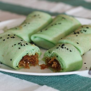 A popular snack in Malaysia, these coconut pandan crepes are made with coconut milk and fresh pandan extract. The filling is a mixture of melted palm sugar and freshly grated coconut.