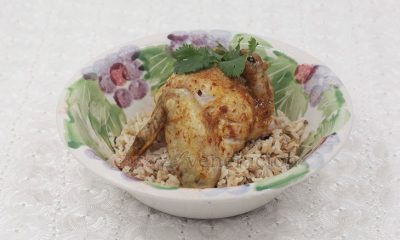 Chinese salt baked chicken is known in the Philippines as pinaupong manok (literally, sitting chicken), so called because the chicken is cooked in a bed of salt.