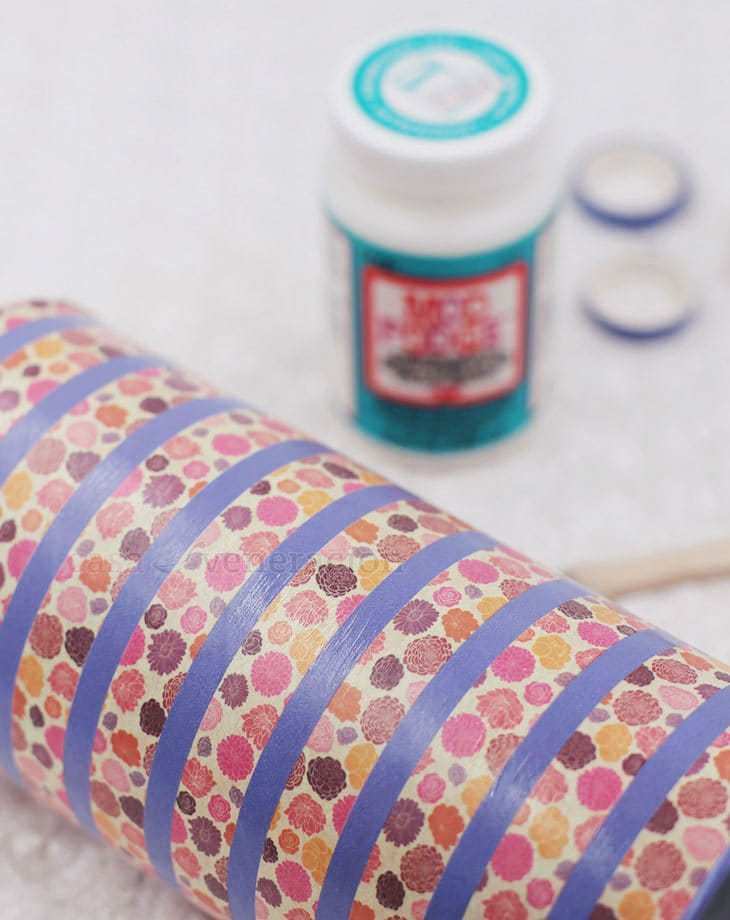 Transform empty canisters into charming vases with spray paint and washi tape. Mix and match patterns with solid colors for a unique look each time!