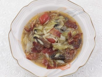 Cooked with bone broth and plenty of herbs, this tomato cabbage orzo soup is made even more tasty with the addition of browned mushrooms and crispy bacon. Enjoy with crusty bread for a light but satisfying meal.