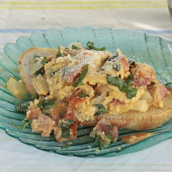 An easy and delicious breakfast, the eggs, tomato and basil are cooked in rendered bacon fat. Serve the scrambled eggs with bacon, tomato and basil over toasted crusty bread sprinkled with Parmesan and more basil.