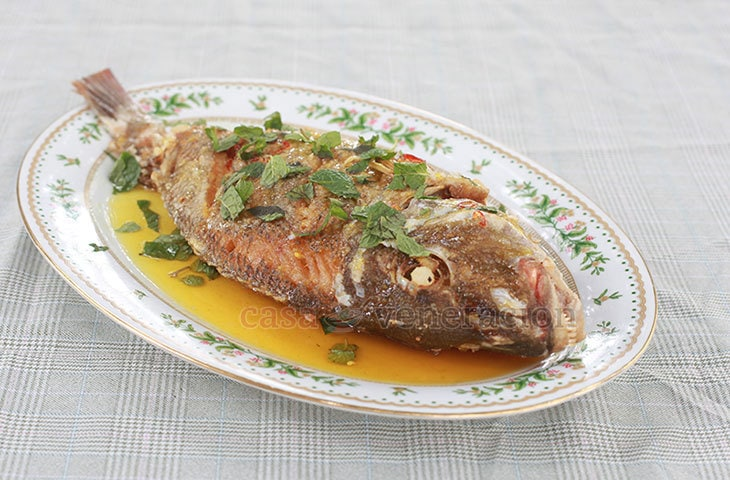 Think Chinese lemon chicken. Substitute a whole fish for the small pieces of chicken, fry the fish to a crisp, lay it on a platter and pour the sticky chili-spiked sweet sour lemon sauce over it. Serve the fried fish with sticky sweet sour lemon sauce with rice for a delightful meal.