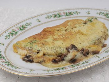 In Episode 11 of Season 14 of The Big Bang Theory, Raj Koothrappali cooked an omelet for his new love interest. The secret, he said, was beating the egg whites separately. This mushroom and cheese omelet was cooked a la Raj. Light and fluffy with melted cheese oozing out.