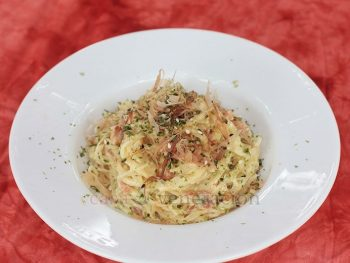 To make Alex's Japanese carbonara, toss angel hair pasta and bacon with cream and salted egg powder. Sprinkle with bonito flakes and furikake, and dig in.