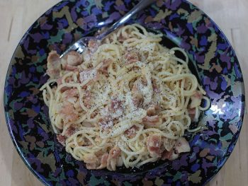 Story has it that spaghetti carbonara was born from food rations after Allied forces liberated Rome in 1944. This is how they must have cooked carbonara with powdered egg, bacon and dried pasta.