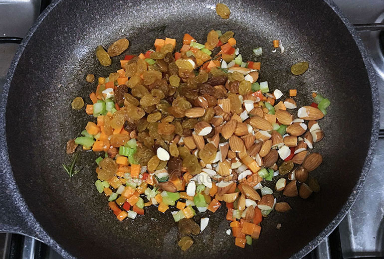 How to cook pilaf: add nuts and raisins (or sultanas) to the aromatics