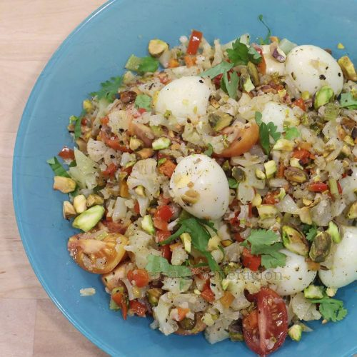 """The flavor base of this cauliflower """"fried rice"""" with quail eggs and pistachio consists of bell pepper, carrot and celery sauteed in butter and olive oil. The colors are beautiful, the flavors are amazing and the texture will not fail to excite the taste buds. It's ovo-lacto vegetarian and keto diet friendly too if those two terms are important to you."""