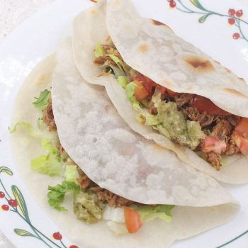 What can be more satisfying than tender pork wrapped in bread and garnished with a tangy salsa? Carnitas tacos with pico de gallo is a lovely snack (or meal) whether or not it's Cinco de Mayo.