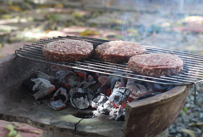 Whether it's the stove top grill or a charcoal grill, I find it essential that the grill be very, very hot before I place the meat on the rack. Why? Because if the grill is not hot enough, the meat will just steam and the burgers will be soggy.