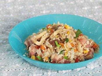 Chunks of pancetta, fresh oyster mushrooms, corn, bell peppers, carrot, rice and scallions. A fast and easy one-pan meal. Get the recipe for pancetta and oyster mushroom fried rice and make your version soon!