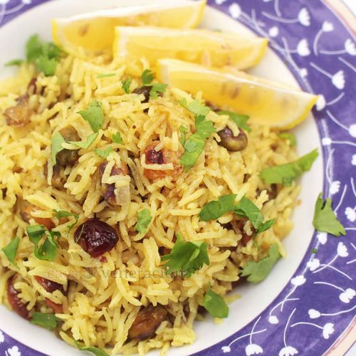A lovely way to enjoy your bowl of rice. Dried cranberries, toasted pistachio nuts and golden raisins are stirred into rice and bone broth tinted with turmeric. A little lemon juice is squeezed over the cranberry and pistachio pilaf just before serving.