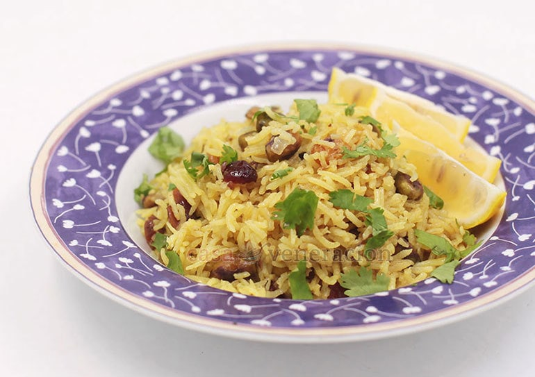 Elevate your rice cooking game by making this delicious cranberry and pistachio pilaf!