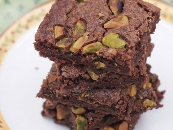 Dry to the touch but moist and chewy inside, these decadently addictive pistachio-topped dark chocolate fudge brownies are so easy to make. Double the recipe for twice the fun!