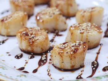 Lightly seasoned pan-seared scallops are drizzled with reduced teriyaki sauce mixed with grated ginger and a little honey. Toasted sesame seeds on top add a lovely contrast in texture. Make these honey ginger teriyaki scallops and fall in love with the flavors.