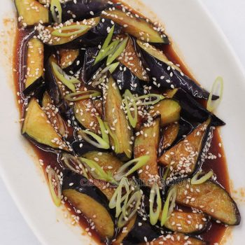To cook soy garlic eggplants, Asian eggplants are sliced and briefly fried. The soy garlic sauce is boiled for a minute and poured over the cooked eggplants. Prep time is around seven minutes; total cook time is less than five minutes.