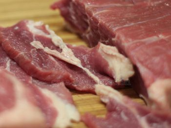 Tips on how to tenderize meat: cut across the grain, pound with a kitchen mallet, soak in baking soda or pureed fruits that contain protease.