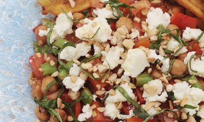 A meatless main dish for vegetarians or a side dish for omnivores, this warm chickpea and green beans salad is garnished with feta, toasted cashew nuts and basil chiffonade.
