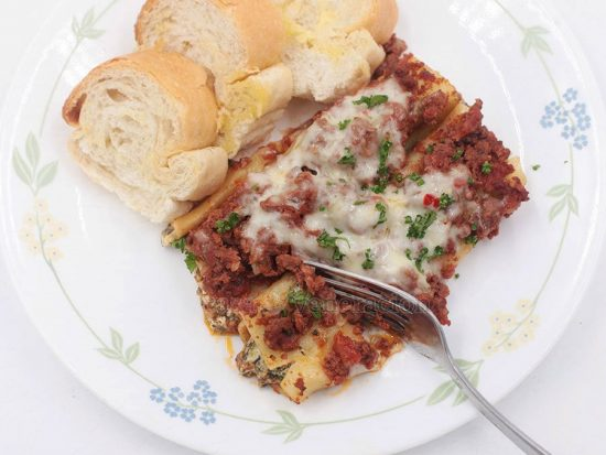 Spinach and Cream Cheese Stuffed Cannelloni With Meat Sauce