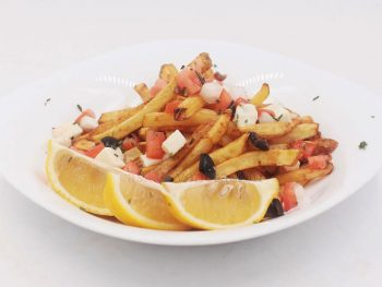 Fried potatoes, French fries style, are topped with chopped tomato, onion, olives and cheese. Squeeze fresh lemon juice over your Greek-inspired fries and sprinkle with chopped fresh rosemary before serving.