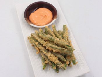 Battered and deep fried, crispy green beans tempura is labeled street fare in P. F. Chang's menu. Here's an easy home version recipe.