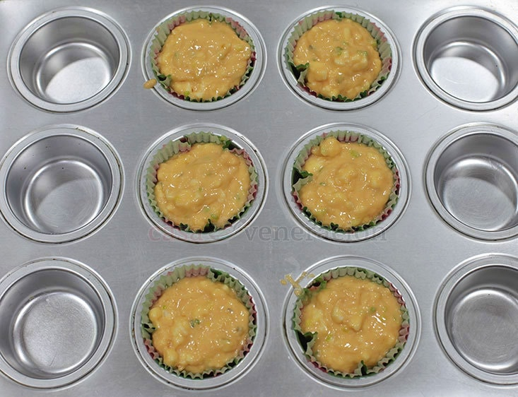 Onion and Kesong Puti (Carabao Milk Cheese) Breakfast Muffins Recipe, Step 5: Spoon the muffin batter into a lined muffin pan and bake