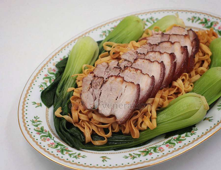 Pork belly is seared, braised, glazed, baked, sliced and arranged over stir fried noodles. This five-spice braised pork belly is also great with rice.