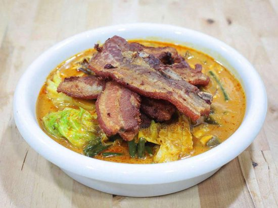 A meat and vegetable stew in peanut sauce, kare-kare is a Filipino dish. Crispy pork belly kare-kare is a modern take on this all-time favorite.