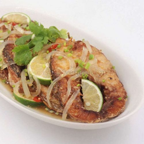 Lighter and fruitier than its Chinese ancestor, the sauce of this Vietnamese-style sweet and sour fish is made with lime juice and not thickened with starch.