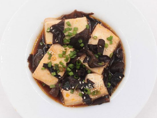 Cubes of silken tofu and wood ear mushrooms are braised in a mixture of soy sauce, rice wine vinegar, mirin, Sriracha and spices. This soy braised tofu and wood ears was inspired by the eternally popular spicy beef stew a la House of Kimchi.