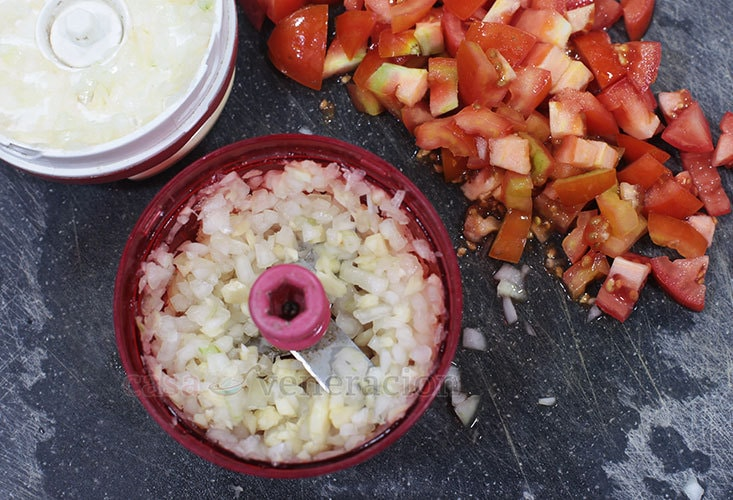 Tomato Soup With Herbed Croutons Recipe, Step 1: Chop the onion, garlic and tomatoes